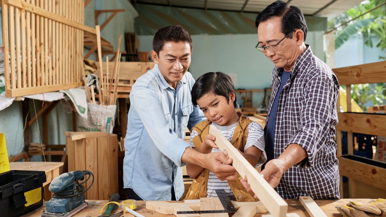 Boy learning woodworking; image used for HSBC Philippines Premier Wealth page