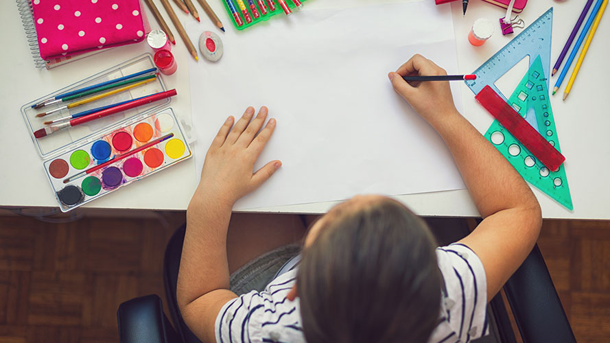 Child drawing at desk; Image used for HSBC Philippines Back to school page