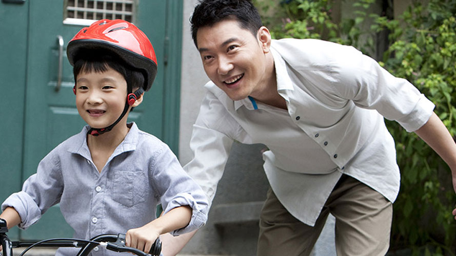 Father and son riding bicycle; image used for HSBC Philippines Insurance