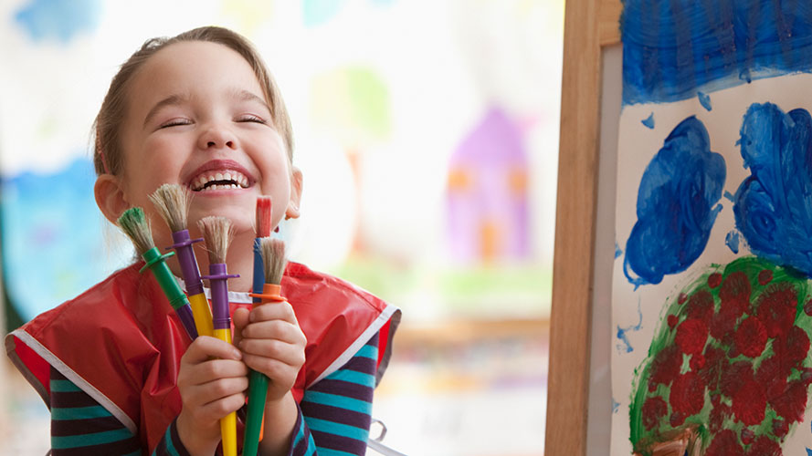 Kid with paintbrushes; image used for HSBC Philippines Back to School Credit Card Offers page