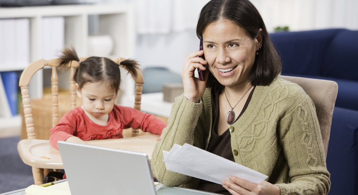 Mom talking on phone beside a child; image used for HSBC Philippines Online Banking FAQs
