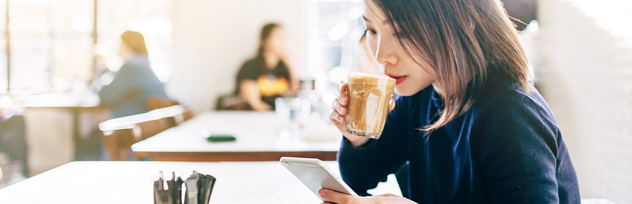 Woman is drinking coffee, image used for HSBC Philippines Ways to bank
