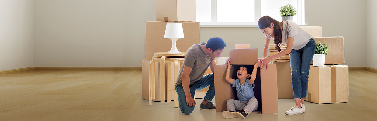Family packing boxes and preparing to move house; image used for HSBC Philippines Personal Loan Application page