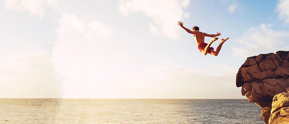 Man jumping into ocean, image used for HSBC Philippines website homepage
