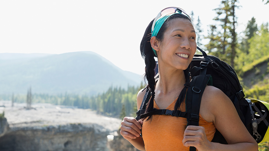 Female backpacker with an adventurous smile;  image used for HSBC Philippines Advance Individual Expertise and Support page