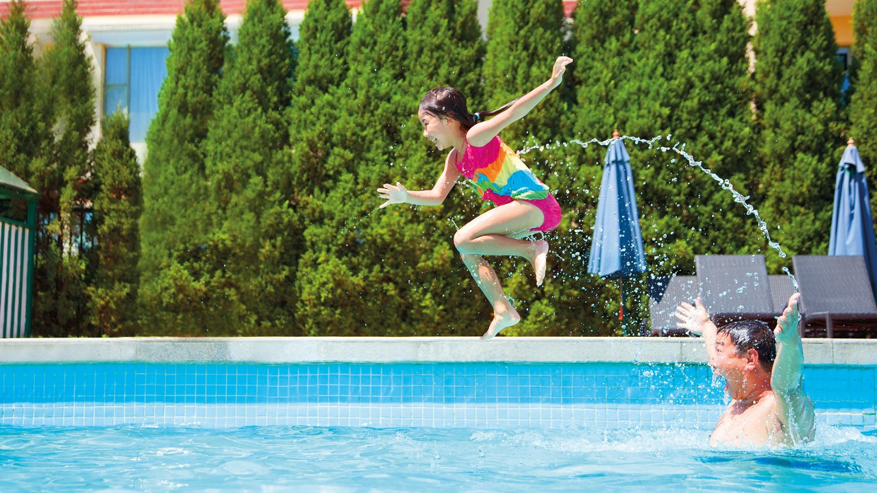 Child jumping into pool;  image used for HSBC Philippines Advance Fast Access More Control page