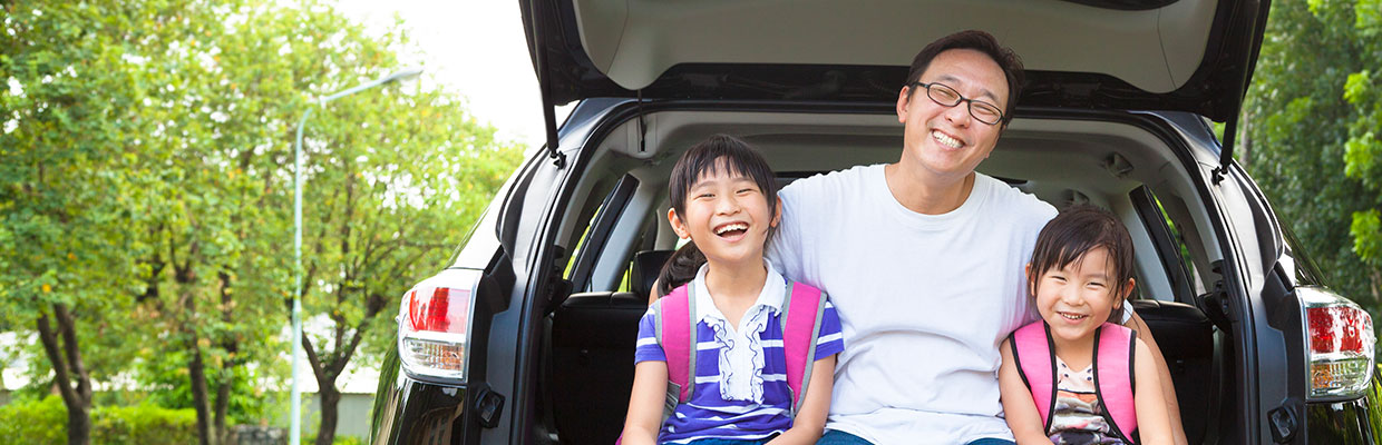 Father and daughters on a car; image used for HSBC Philippines Credit Cards Features Caltex Rebate page