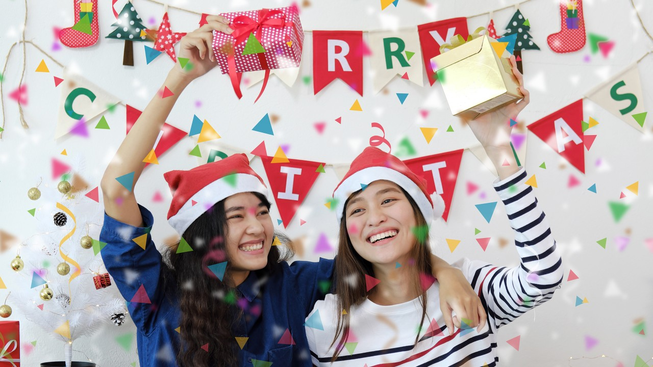 Two teenage girls celebrating Christmas at a party; image used for HSBC Philippines Credit Card Offers Free for Life Single Girl page