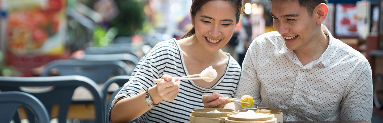Happy couple eating dim sum; image used for HSBC Credit Card Offers - Red Hot Deals