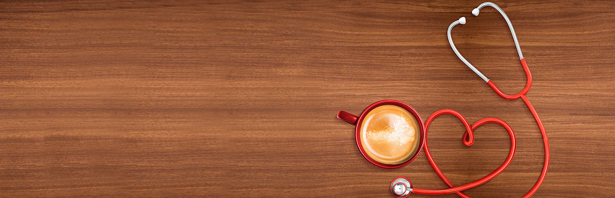 coffee and stethoscope on table; image used for the HSBC Philippines Tim Hortons Donation page