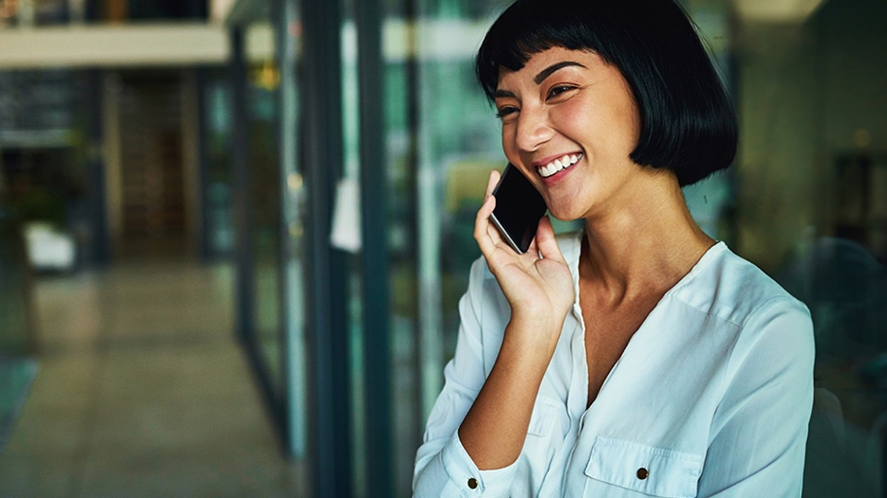women laughing on phone; image used for HSBC Philippines Telephone banking page