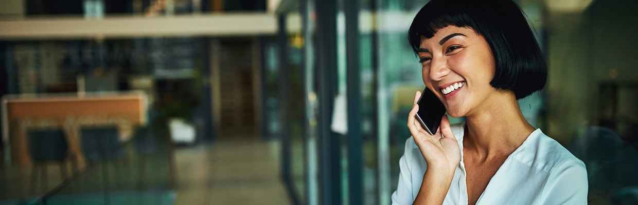 A girl is talking on phone, image used for HSBC Philippines Telephone banking page